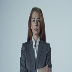 Serious Businesswoman Looking at Falling Money Stock Footage