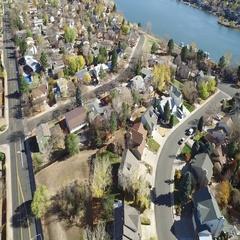 A residential neighborhood near a river, seen from far above COLORADO Stock Footage
