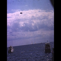 Vintage 16mm film, 1962 Americas Cup, flotilla and blimp b-roll Stock Footage