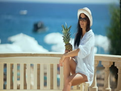 Pretty woman with tropical cocktail on the beach enjoying sunny weather Stock Footage