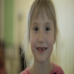Toothless little girl laughing. Stock Footage