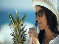Young pretty woman drinking tropical cocktail on the beach. Stock Footage