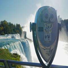 Telescope for viewing the Niagara Falls. A popular destination among tourists Stock Footage