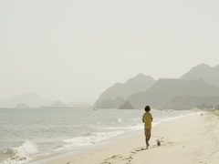 Man playing football at the beach. Stock Footage