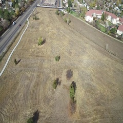 Aerial view of lot at edge of town beside the freeway COLORADO Stock Footage
