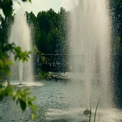 The fountain in the park and a lot of pipes on a background of green summer Stock Footage