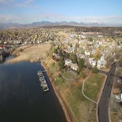 Aerial view of a quaint, small town along a shoreline. COLORADO Stock Footage