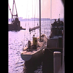 Vintage 16mm film, 1962 Americas Cup, yacht Weatherly at dock Stock Footage