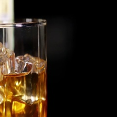 Glasses of malt whiskey on a black table Stock Footage