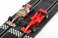 Slot car racing track with formula one cars Stock Photos