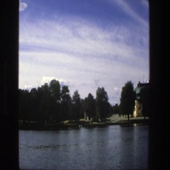 1975: a line of trees and house lining a body of water STOCKHOLM SWEDEN Stock Footage