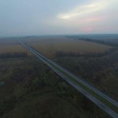 Aerials. Motorway passes through picturesque nature Stock Footage