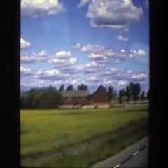 1975: sightseeing a small town from a moving car. SWEDEN Stock Footage