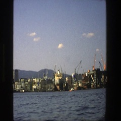 1975: an area by the water that has a cranes with the arm in the air STOCKHOLM Stock Footage