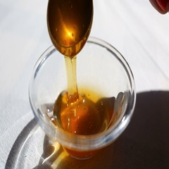 Spoon with honey in sunlight Stock Footage