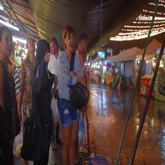 People shelter in rainy season in Pattaya, Thailand Stock Footage