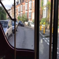 A passenger runs to catch a New London Routemaster Bus Stock Footage