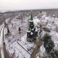 Aerial view at wooden church on the main avenue of Segezha. Winter in Russia Stock Footage