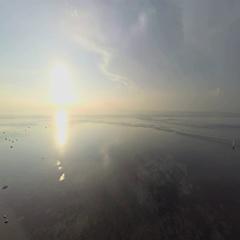 Aerial shot of sunrise in Sanur beach, camera panning left Stock Footage