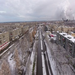 Camera flies over Russian provincial town center at winter. Karelia, Russia Stock Footage