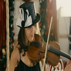 Blond sexy woman playing violin, posing for a fashion magazine. Stock Footage