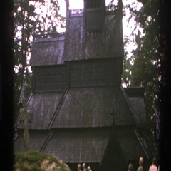 1976: walking amongst a group of people to view a large monument and church Stock Footage