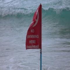 NAI HARN BEACH, PHUKET, THAILAND Red flag on the beach Stock Footage