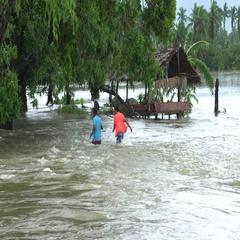 People Wade Through Dangerous Fast Flowing Flood Waters Stock Footage