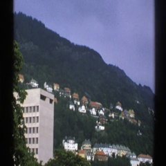 1976: view of a small habitated village located next to a hill NORWAY Stock Footage