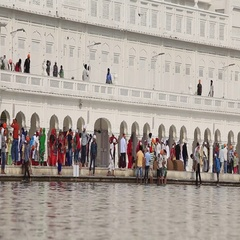 People visiting the Golden Temple in Amritsar, Punjab, India Stock Footage