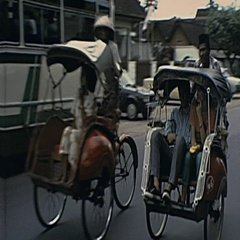 Java 1982: bicycle taxi (rickshaw) in the street Stock Footage