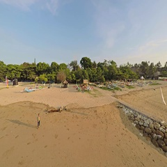 Aerial shot of sunrise in Sanur beach, camera facing and going along the beach Stock Footage