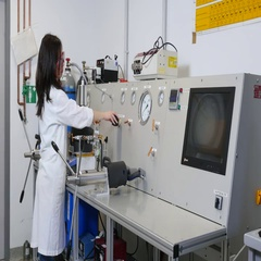 Geologist at the high-pressure apparatus in the laboratory. Stock Footage