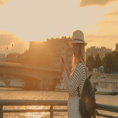 Woman tourist in Paris. Traveller female shooting phone beautiful sunset Stock Footage