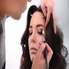 Make up for beautiful caucasian model, girl comes to beauty fashion salon Stock Footage