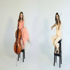 Sexy girlfriend sitting on high chairs with musical instruments. Stock Footage