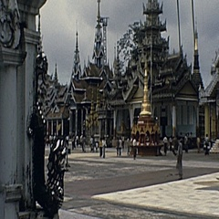 Burma 1986: visitors in front of a temple Stock Footage