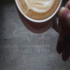 Man puts a cup of latte art coffee on the bar, slow motion 480 fps Stock Footage