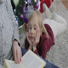 Grandmother reading book to his lovely little granddaughter. Stock Footage