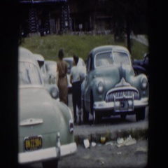 1951: two people walking across a parking lot WYOMING Stock Footage