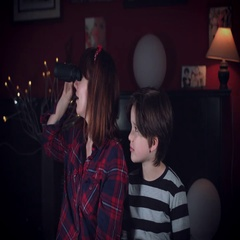4k Family Home Shot of Child with Mum Looking through a Binocular  Stock Footage