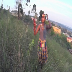 Traditional rural zulu girl taking a selfie with cellphone Stock Footage