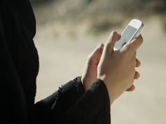 Arab woman texting on mobile. Stock Footage