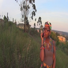 Traditional rural zulu girl speaking on mobile cell phone telephone Stock Footage