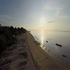 Aerial shot of sunrise in Sanur beach, camera panning left towards the beach Stock Footage