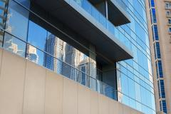 Part of a multi-storey office building glass Stock Photos