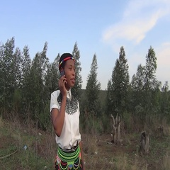 Traditional rural black zulu girl speaking on mobile cell phone telephone Stock Footage