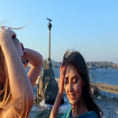 Beautiful girls doing selfie on the mobile phone on the background of the Stock Footage