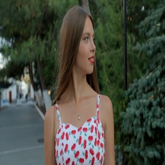 Sensual girl with long hair in sundress walking through the park Stock Footage