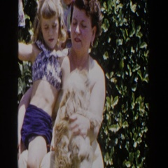 1953: woman and child petting a dog. LUBBOCK TEXAS Stock Footage